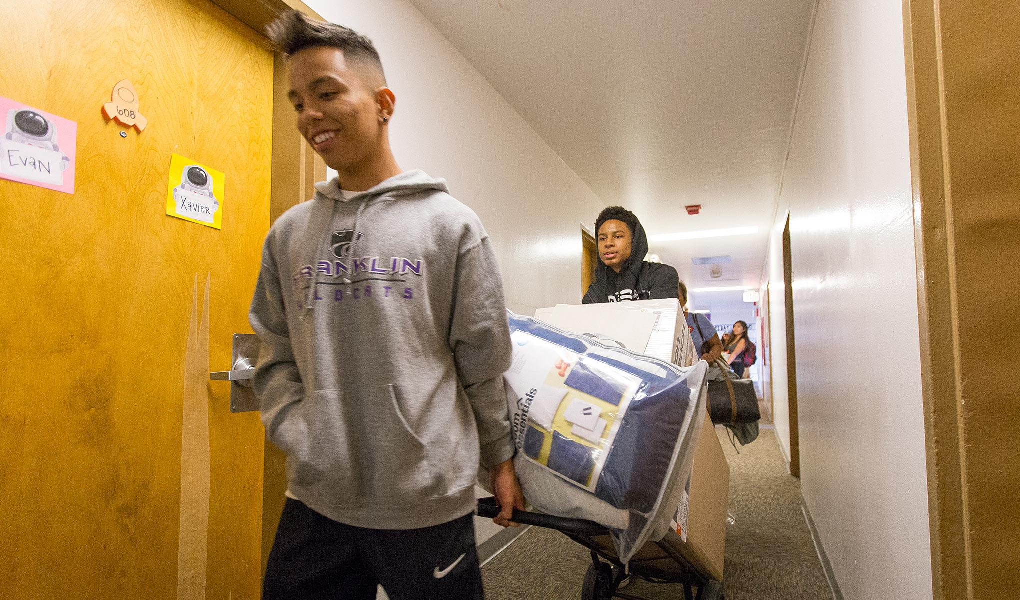 Two new SF State students moving into the residence halls.