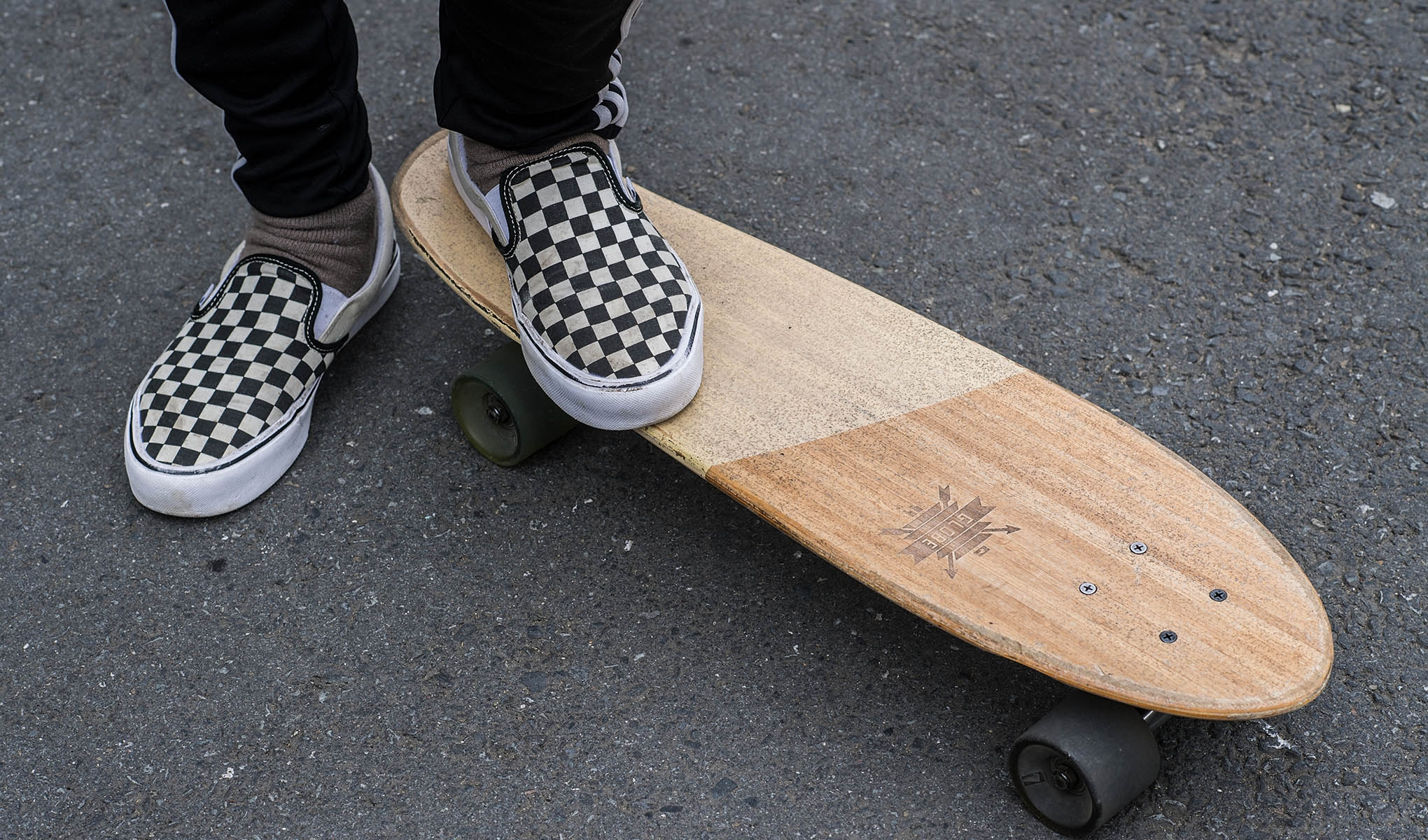 One foot on skateboard